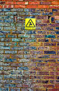 Old brick wall with warning sign Royalty Free Stock Image