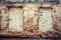 Old brick wall an with window openings closed with bricks Royalty Free Stock Photos