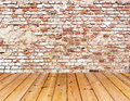 Old brick wall on wood floor interior with Stock Image