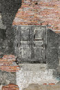 Old brick wall and wooden window Royalty Free Stock Photo