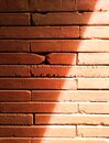 Old brick walls are red, orange and shadow from the sunshine Royalty Free Stock Photo