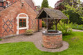 Old bricked well in a garden Stock Photography