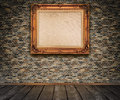 Old bricks wall and old fashioned wooden frame with dirty canvas Stock Image
