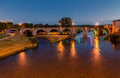 Old bridge carcassonne france the arches of the stone pont vieux over the aude river in at night Stock Photography