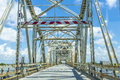 Old bridge in east area of new driving on chef menteur highway with orleans crossing the bay Royalty Free Stock Photo