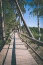 old bridge in forest - vintage film effect