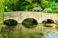 Old bridge over river Coln in village Bibury England Royalty Free Stock Photo