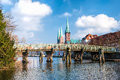 The old bridge over trave river lübeck scene of cityscape was shot in evening is second largest city in schleswig holstein in Stock Photo