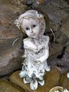 Old broken angel statue with blue eyes Royalty Free Stock Photo