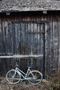 Old broken bicycle at an village barn Royalty Free Stock Photo