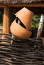 Old broken clay pot close up at wattle fence. Rural scene. Royalty Free Stock Photo