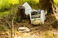 Old broken computer dumped in the woods Royalty Free Stock Photo