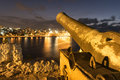 Old bronze cannon aiming at Old Havana from a historic fortress Royalty Free Stock Photo