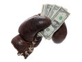Old brown boxing glove with dollars Royalty Free Stock Images