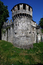 Old brown castle brick and battlement in the grass of bellinzona switzerlan Royalty Free Stock Photos
