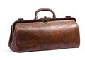 Old brown doctors bag or holdall with a textured surface viewed closed with the handle raised up isolated on white in a medical Stock Image