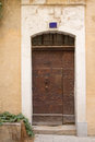 Old brown entrance door wooden to the house mediterranean architecture Royalty Free Stock Photography