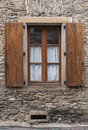 Old brown shutters on a stone wall Royalty Free Stock Photos