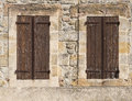 Old brown shutters on a wall in france Stock Photo
