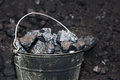 Old bucket with large pieces of coal Royalty Free Stock Photo