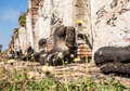 Old buddha statue was ruined at ayutthaya province and tourist attraction in thailand watpramahathat Royalty Free Stock Image