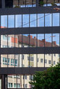 Old building architecture reflected in modern building Royalty Free Stock Photo
