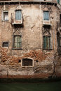 Old building exterior an along a canal in venice italy Stock Photography