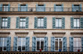 Old building exterior in paris with windows and balconies Stock Photos