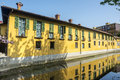 Old building on the martesana milan yellow and canal in lombardy italy at spring Royalty Free Stock Photo