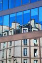 Old building reflects in windows in Paris Royalty Free Stock Photo