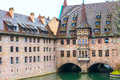 Old buildings and arch bridge reflected in water. Nuremberg, Bavaria Royalty Free Stock Photo