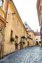 Old buildings on enescu square and entrance in the bistro de l arte one of the hidden jewels of the medieval brasov historical Royalty Free Stock Image