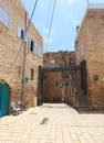 Old buildings and modern structure in acre two with the support of a a typical pedestrian street the quarter of the city of or Royalty Free Stock Photo