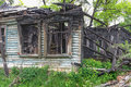 Old burned out wooden abandoned mansion Royalty Free Stock Photo