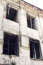 Old burnt house with charred wooden windows bottom view Stock Photography