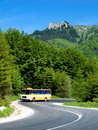 Old bus in mountain highway Royalty Free Stock Image