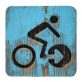Old bycicle symbol on blue wooden background Royalty Free Stock Photo