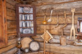 Old cabin with home made tools on the wall hand carved wooden hang of an Royalty Free Stock Photo