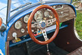 Old cabrio car steering wheel vintage beautifully restored interior of an ancient sports rebuilt from syrena on a show in gdansk Royalty Free Stock Images