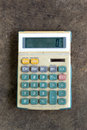 Old calculator dusty on ground floor Royalty Free Stock Photo