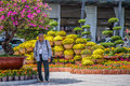 An old camera man camera man is standing in the garden in the center of saigon vietnam to provide photo service for people w ho Royalty Free Stock Photography