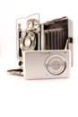 Old camera and new compact camera conceptual image about the evolution of technology in photography photo isolated on white Royalty Free Stock Photo