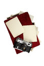Old camera and picture album with photos isolated on white background Royalty Free Stock Images