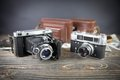 Old camera on the wooden table Royalty Free Stock Photo
