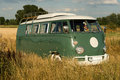 Old camper an minibus standing on a summer field Royalty Free Stock Photography