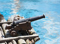 Old cannon mounted on the shore Royalty Free Stock Photo