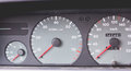 Old car dashboard of the 90s with speedometer, tachometer... Royalty Free Stock Photo