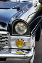 Old car detail left headlight view Stock Image