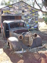 Old car in front of a shed with number plates on it s wall in western australia Royalty Free Stock Photo