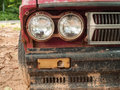 Old car headlights in rainy day Stock Image